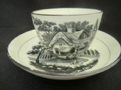 NOT AVAILABLE  Black printed bute shaped cup & saucer